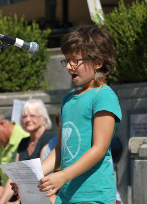 child protests climate change at rally Oregon Mary DeMocker